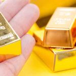 gold bullion bar in hand